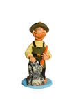 Figurine fisherman with fish Stock Photography