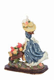 Figurine of Girl with wheelbarrow full of flowers Royalty Free Stock Photos