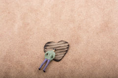 Figurine and Heart shaped burnt out of a cardboard Stock Photo