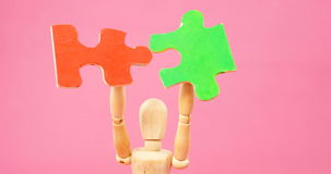 Figurine holding jigsaw puzzle stock video footage