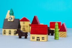 Figurine hometown. On blue background Royalty Free Stock Images