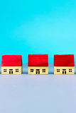 Figurine houses. Figurine wooden houses on blue background Stock Photography