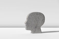 Figurine of humans head on white background Stock Photos