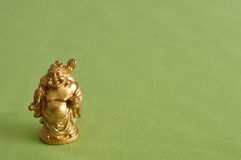 Figurine of a laughing and cheerful golden Buddha Royalty Free Stock Image