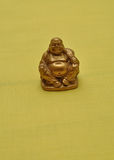 Figurine of a laughing and cheerful golden Buddha Stock Images