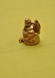 Figurine of a laughing and cheerful golden Buddha Stock Image