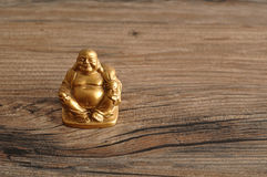 Figurine of laughing golden Buddha Royalty Free Stock Image
