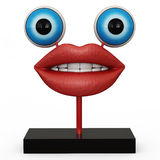 Figurine lips with blue eyes. On white backgraund Royalty Free Stock Images
