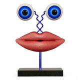 Figurine lips with blue eyes. On white backgraund Stock Photography