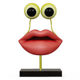 Figurine lips with yellow eyes. On white backgraund Stock Image