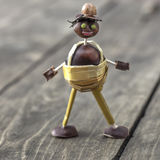 Figurine made of chestnuts Royalty Free Stock Photo