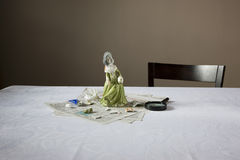 Figurine And Magnifying Glass On Table Stock Photography