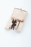 Figurine of man pensioner on mouse trap Stock Photography