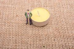 Figurine man standing on canvas Stock Photo