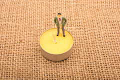 Figurine man standing on canvas Royalty Free Stock Images