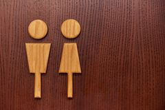 Figurine of a man and a woman. On a wooden door Stock Photography