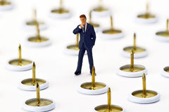 Figurine from Manager with thumbtack Royalty Free Stock Images