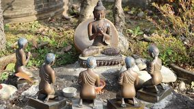 Figurine of meditating Buddha and disciples stock video footage