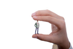 Figurine model men in hand. On a white background Royalty Free Stock Photo