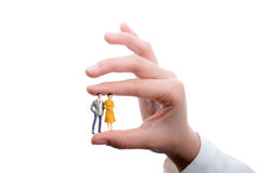 Figurine model men in hand. On a white background Royalty Free Stock Photography