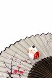 Figurine of Monkey. Figurine of Monkey, and a Japanese folding fan. (Japanese New Year customs Stock Photo