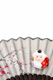 Figurine of Monkey. Figurine of Monkey, and a Japanese folding fan. (Japanese New Year customs Royalty Free Stock Photography