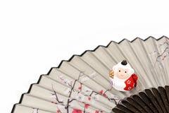 Figurine of Monkey. Figurine of Monkey, and a Japanese folding fan. (Japanese New Year customs Royalty Free Stock Photos