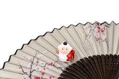 Figurine of Monkey. Figurine of Monkey, and a Japanese folding fan. (Japanese New Year customs Royalty Free Stock Photo