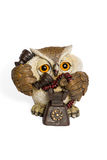 Figurine owl talking on the phone Royalty Free Stock Photo