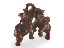 The figurine of a pair of elephants, mahogany. On a white background Stock Images