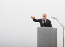 Figurine of a politician speaking to the people Stock Image