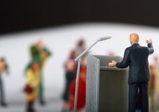 Figurine of a politician speaking to the people Royalty Free Stock Image