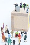 Figurine of a politician speaking to the people. Miniature figurine of a politician speaking to the crowd on an election rally Royalty Free Stock Photo