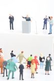 Figurine of a politician speaking to the people. Miniature figurine of a politician speaking to the crowd on an election rally Stock Images