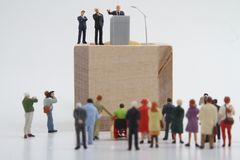 Figurine of a politician speaking to the people. Miniature figurine of a politician speaking to the crowd on an election rally Royalty Free Stock Photos