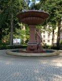 Figurine of Poznanski. Fontana figurine on the palace square in Lodz Poznanski Royalty Free Stock Photography