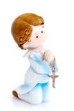 Figurine of praying girl Stock Images