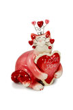 Figurine red cat with inscriptions about love. Gift red cat statuette with the words Love you isolated on a white background Royalty Free Stock Photo