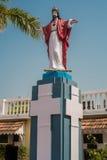 Figurine sacred against church Royalty Free Stock Photos