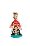 Figurine sailor at the helm Royalty Free Stock Photo