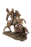 Figurine of Saint George. Bronze figurine a warrior on a horse wins a dragon isolated on a white background Stock Photography