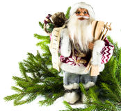 Figurine of Santa Claus and bag with gifts on the background of. The figure of Santa Claus and green spruce branch on white background Stock Images