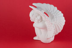 Figurine se reposante d'ange Photographie stock