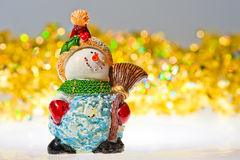 Figurine snowman and tinsel Royalty Free Stock Photo