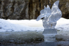 Figurine squirrel from ice in the cave. The marble quarry of Ruskeala in Karelia, an underground lake royalty free stock photo