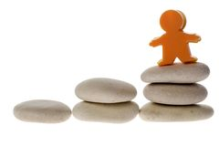 Figurine on stack of pebble Royalty Free Stock Images