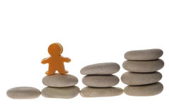 Figurine on stack of pebbles Royalty Free Stock Image
