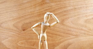 Figurine standing with hand on head. Conceptual image of figurine standing with hand on head stock footage