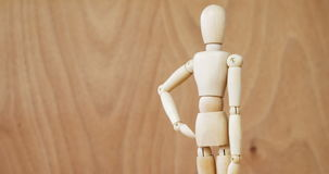 Figurine standing with hands on hip. Conceptual image of figurine standing with hands on hip 4k stock footage