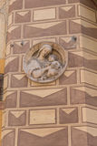 Figurine symbol on old house wall. Salsomaggiore Royalty Free Stock Photo
